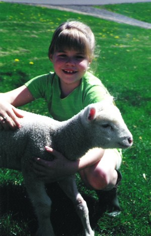 Me and one of the lambs I raised in elementary school.
