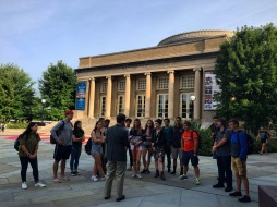 Tour of Cornell College of Agriculture & Life Sciences with Corey Earle '07. Class standing in front of Bailey Hall.