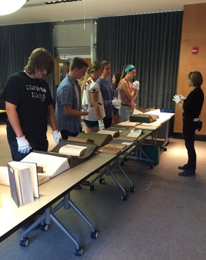 Students viewing Mann Library archive material.
